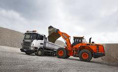 Sklápěč G 480 6x4 i kolový nakladač Doosan DL450 pohání stejný motor Scania