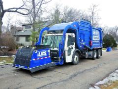 Čelní nakladač pro svoz komunálního odpadu napodvozku MACK řady LR.